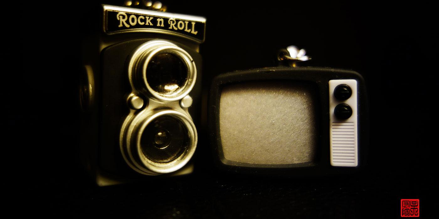 Vintage film camera and vintage television set